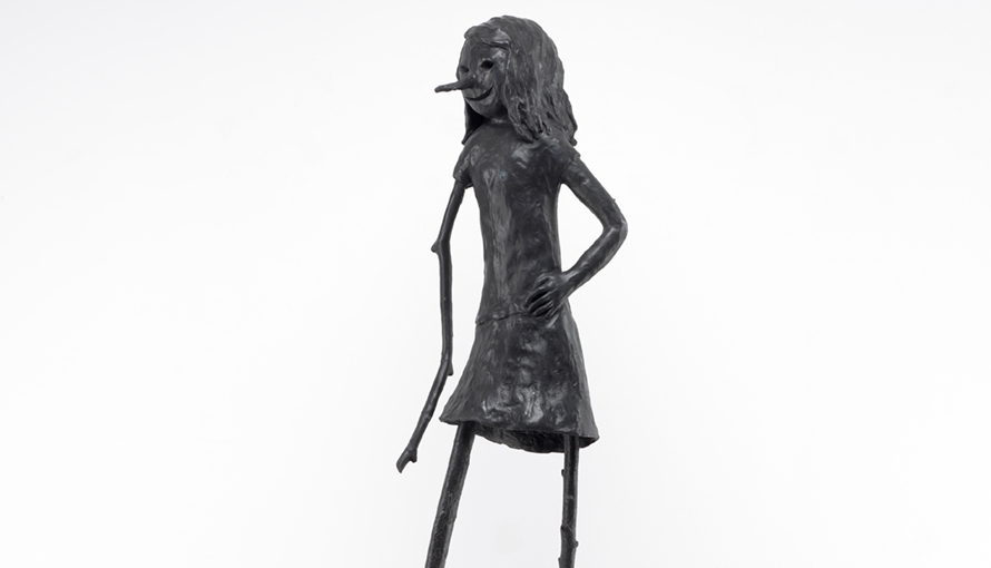 Bronze sculpture with black patination of a female creature.